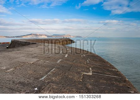 The Cobb harbour wall at Lyme RegisDorset .The town lies in Lyme Bay on the English Channel coast at the Dorset Devon border