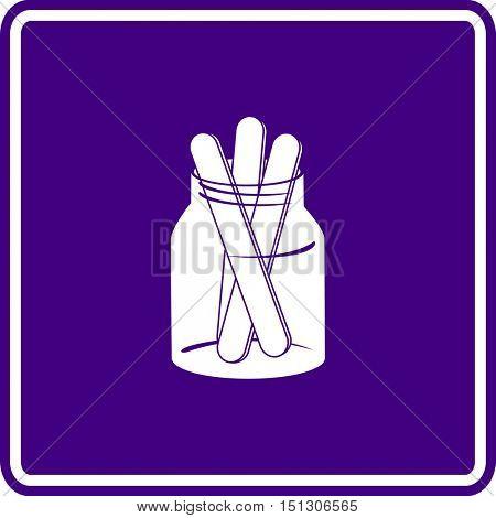 tongue depressors in glass jar sign