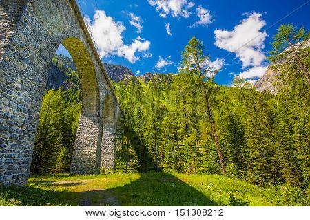 Famous Landwasser Viaduct Bridge In Albula Pass. The Rhaetian Railway Section From The Albula/bernin