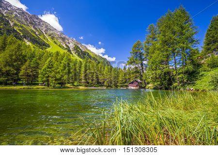 Beautiful Chalet On Palpuognasee In Swiss Alps, Albulapass. Albulapass Is A Swiss Mountain Pass In T