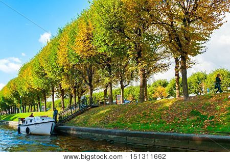 ST PETERSBURG RUSSIA - OCTOBER 3 2016. Autumn landscape of St Petersburg Russia - Moika river embankment and autumn trees in sunny autumn day in St Petersburg Russia