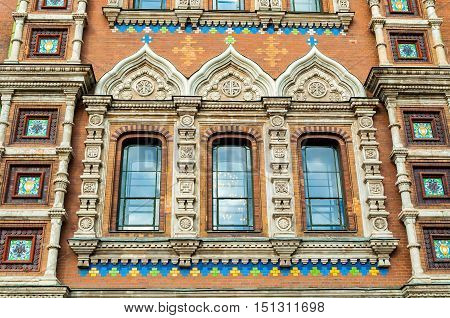 Cathedral of Our Savior on Spilled Blood in Saint Petersburg Russia - closeup of windows of the cathedral decorated with architectural and sculptural elements mosaics and enamel