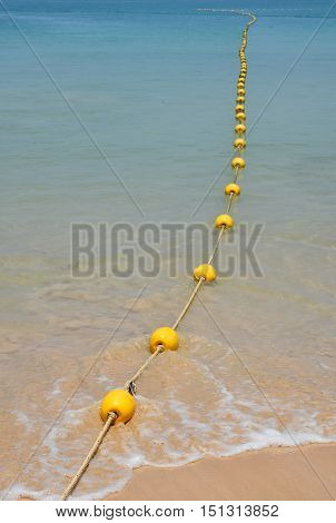 Yellow Buoys At Sea Beach And In Water