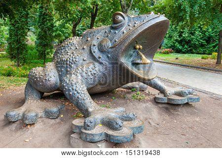 KIEV UKRAINE - SEPTEMBER 23 2016: Frog sculpture moneybox in Mariinsky Park. Kiev Ukraine.