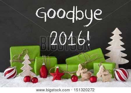 English Text Goodbye 2016 For Happy New Year. Green Gifts Or Presents With Christmas Decoration Like Tree, Moose Or Red Christmas Tree Ball. Black Cement Wall As Background With Snow.