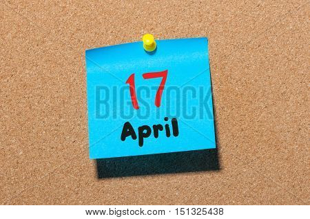 April 17th. Day 17 of month, calendar on cork notice board, business background. Spring time, empty space for text.