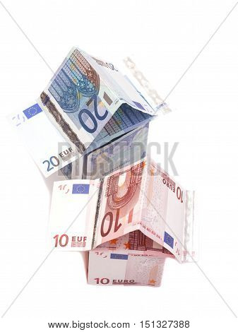 House Made From Ten And Twenty Euro Banknotes isolated