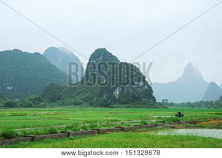 The beautiful karst mountains and rural scenery in Guilin, China.