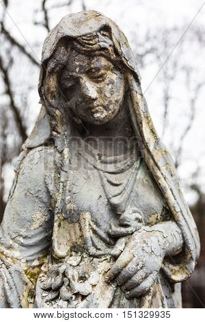 Old cemetery marble sculpture of the young girl.