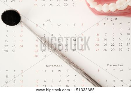 Dentist Tool And Demonstration Teeth Model On Calendar