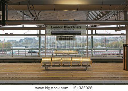 LONDON UNITED KINGDOM - NOVEMBER 24: Blackfriars Bridge Train Station Platform in London on NOVEMBER 24 2013. Newly Renovated Blackfriars Station Over the Thames River in London United Kingdom.