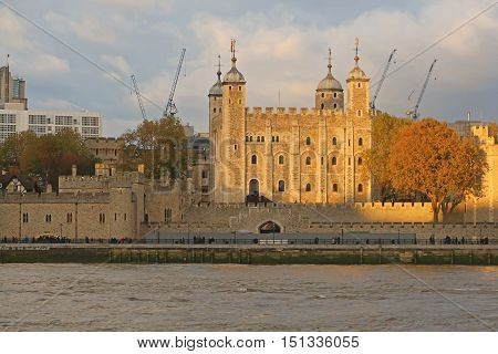 LONDON UNITED KINGDOM - NOVEMBER 23: Tower of London on NOVEMBER 23 2013. Royal Palace and Fortress White Tower of London at Thames RIver in London United Kingdom.