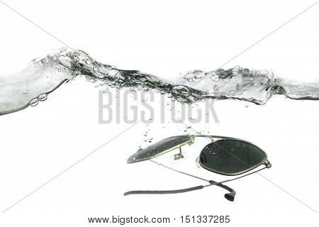 glasses fall in water splash bubbles show motion on white background with copy space.
