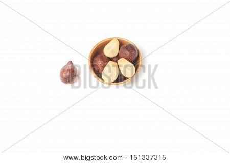 Salak fruit Salacca zalacca in cup on white background