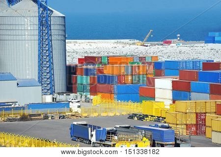 Cargo Container, Pipe And Grain Drayer In Port