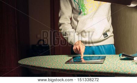Young man listening to your favorite music on the computer tablet