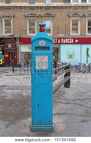 LONDON UNITED KINGDOM - NOVEMBER 24: Police Telephone Post in London on NOVEMBER 24 2013. Retro Style Police Phone Post in London United Kingdom.