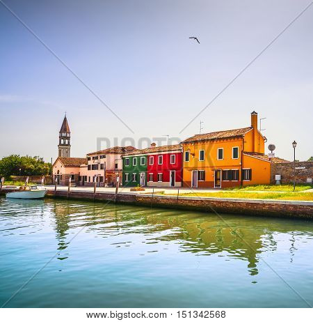 Venice landmark Burano island canal colorful houses church and boats Italy. Long exposure photography