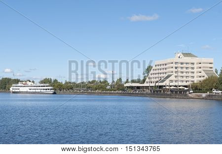 Vyborg, Russia September 03, 2016: Embankment in the city of Vyborg. Moored the ship and the building in Vyborg, Russia