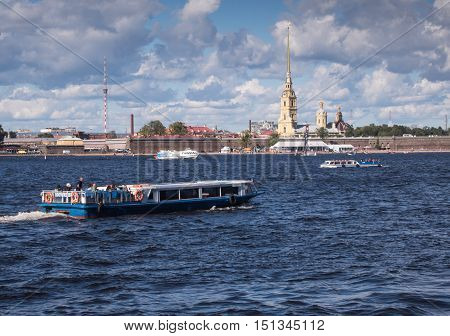 Saint Petersburg Russia Septembert 05, 2016: tour boat in the background is the Peter and Paul fortress in St. Petersburg, Russia.