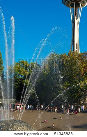 SEATTLE WA - SEPTEMBER 10 2016: The International Fountain and the Space Needle both built for the 1962 World's Fair are twin attractions at the city's popular Seattle Center.