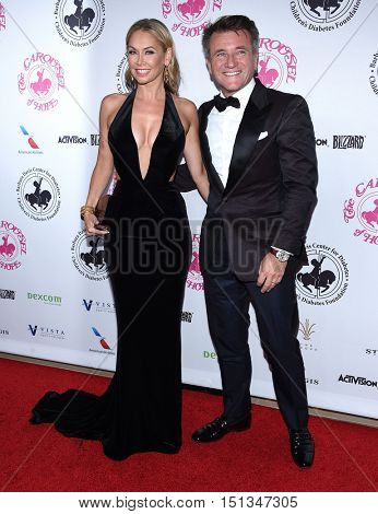 LOS ANGELES - OCT 8:  Robert Herjavec and Kym Johnson arrives to the Carousel of Hope 2016 on October 8, 2016 in Hollywood, CA