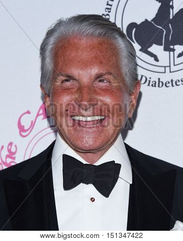 LOS ANGELES - OCT 8:  George Hamilton arrives to the Carousel of Hope 2016 on October 8, 2016 in Hollywood, CA