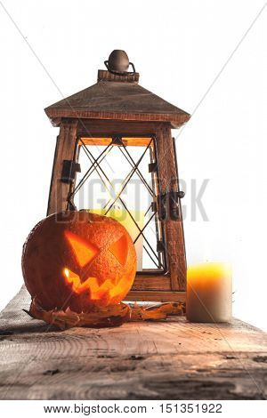 Halloween pumpkin and lantern with candle on white background