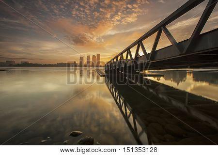 cloudy hazy morning skyline lake view sunrise bridge reflection