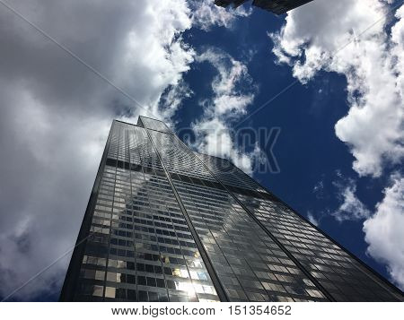 high skyscraper tower building low angle reflection view cloudy blue