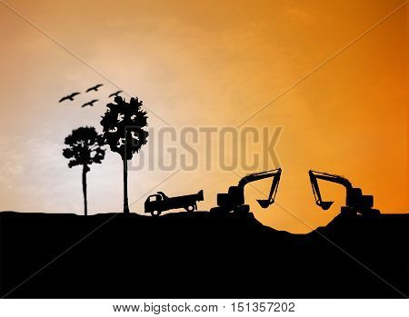 silhouette Loaders and trucks in a building site