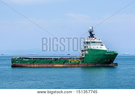 Labuan,Malaysia-Aug 19,2016:The supply vessel transporting cargo at Labuan sea.Labuan strategically located in the hub of Asia-Pacific and the ASEAN offshore oil exploration and production region.