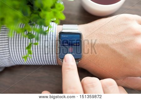 Man hands and smart watch with debit card touch and pay on screen