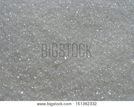 Granulated sugar. Sugar sand as background. Sugar background. Natural background.