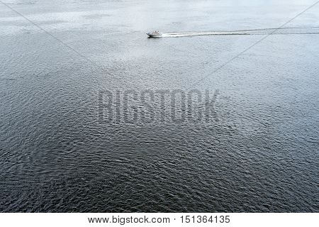 The motor boat floating in the Dnieper waters.