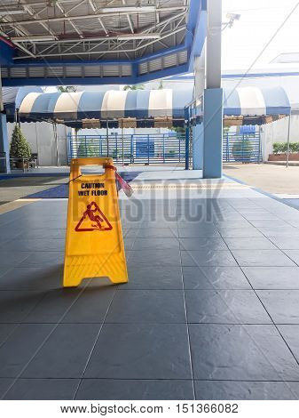 Caution wet floor or cleaning in progress. A yellow sign warning for the area was cleaned.