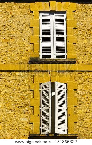 French Windows with Closed Wooden Shutter in Medieval City of Sarlat