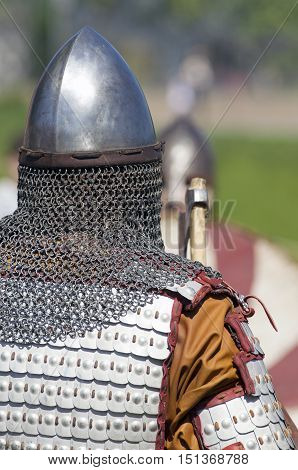 The reconstructed protective armor of Vikings on the soldier standing a back (St. Petersburg Russia)