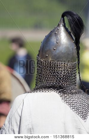 Protective chain armor and a helmet on the soldier standing a back (St. Petersburg Russia)