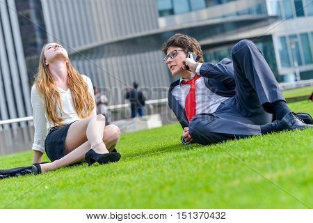Business Team Sitting On The Grass During A Break