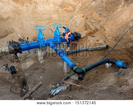 Technical Expert Open Gate Valve On 500Mm Drink Water Pipe. Man Control  Finished Repaired Piping Be