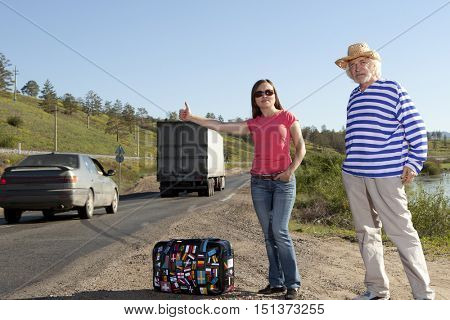 Hitchhiking travel man and woman at the route