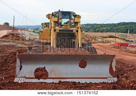 Bulldozer working on a road construction site