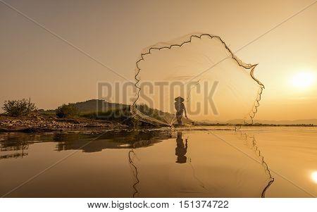 Fishermen on boat fishing at lake .