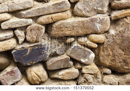 Old masonry stone wall from and aged building facade