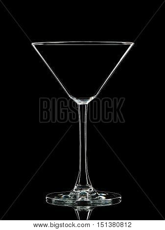 Silhouette of white martini glass with clipping path on black background.