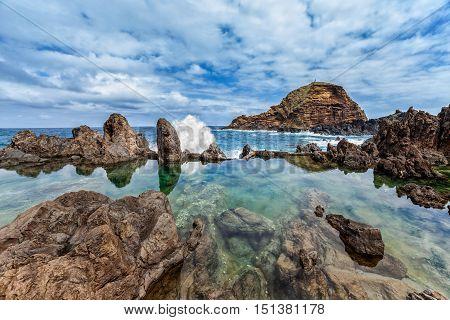 Lava rocks natural volcanic pools in Porto Moniz Madeira Portugal.