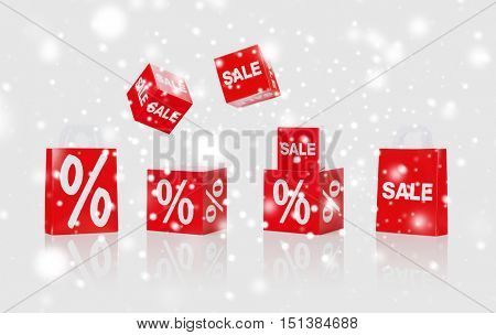 christmas, winter, retail, advertisement and merchandising concept - set of boxes and shopping bags with sale and percent sign over snow background