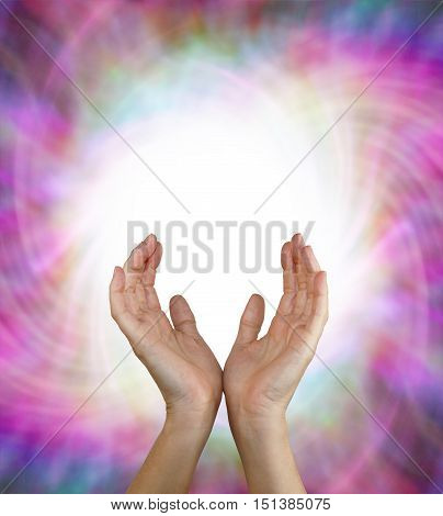 Vortex Energy Field - Female energy worker with hands outstretched and open upwards sensing white healing energy on pink vortexing multicolored energy formation background