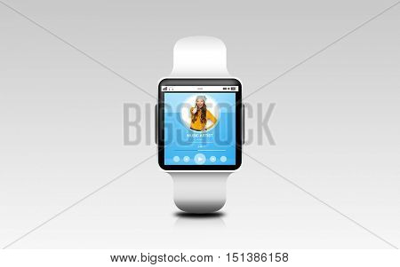 modern technology, object and media concept - close up of black smart watch with music player on screen over gray background